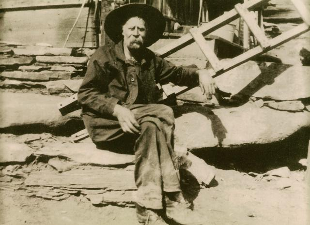 John Christian – sitting on the steps of his Cabin taken between 1906 and 1915.